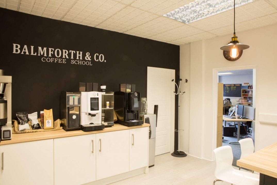 Barnsley office space used as a coffee school, countertops filled with coffee machines and ingredients